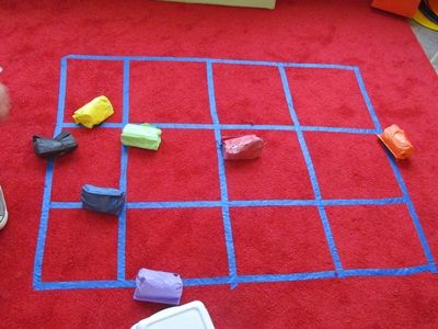 Paper bag beanbag game... 1 c beans in plastic baggie; roll up in paper sack; toss onto grid made with tape.