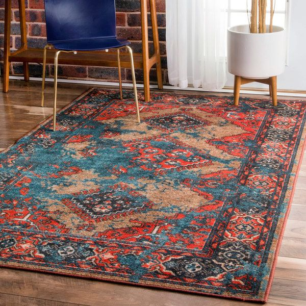this machine-made 100-percent nylon rug features a vintage style