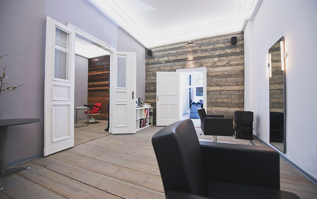 @getbelliata love the interior Touché Friseure in our neighborhood in Berlin.  It is a simple interior design for a hair salon, with natural wood used as a feature wall, otherwise white walls and nice lighting.