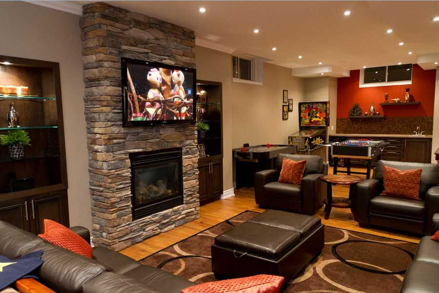 Basementfamilyroomideaswithtelevisionovernaturalstone - Basement fireplace design ideas