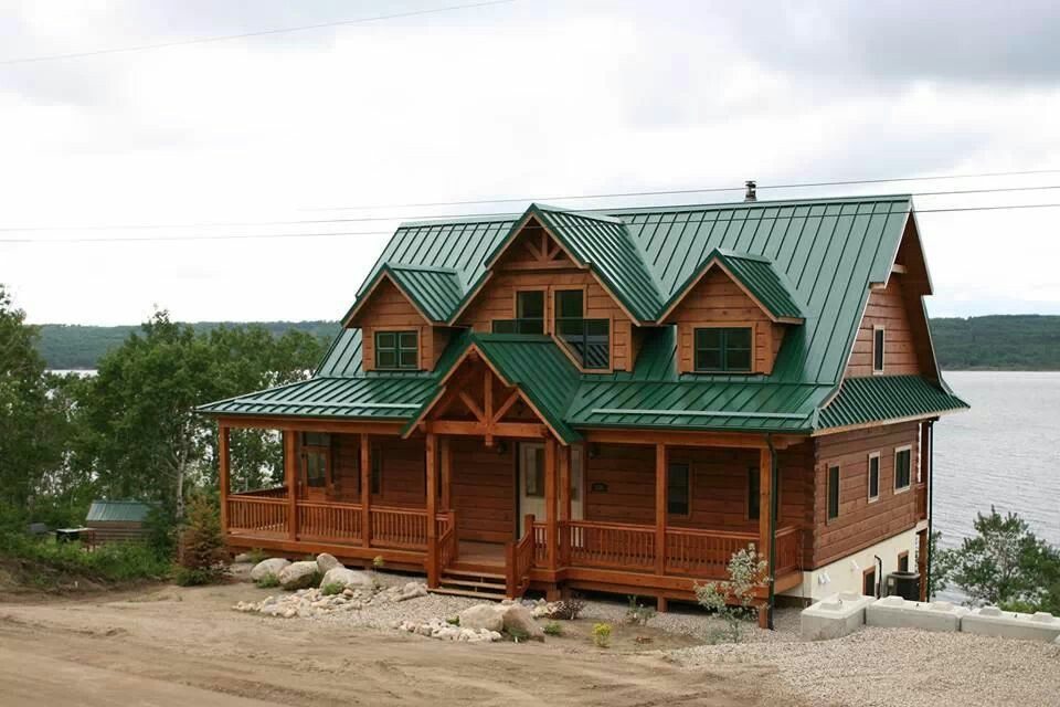 Log cabin love the green tin roof but i 39 d want a wrap Cabins with metal roofs