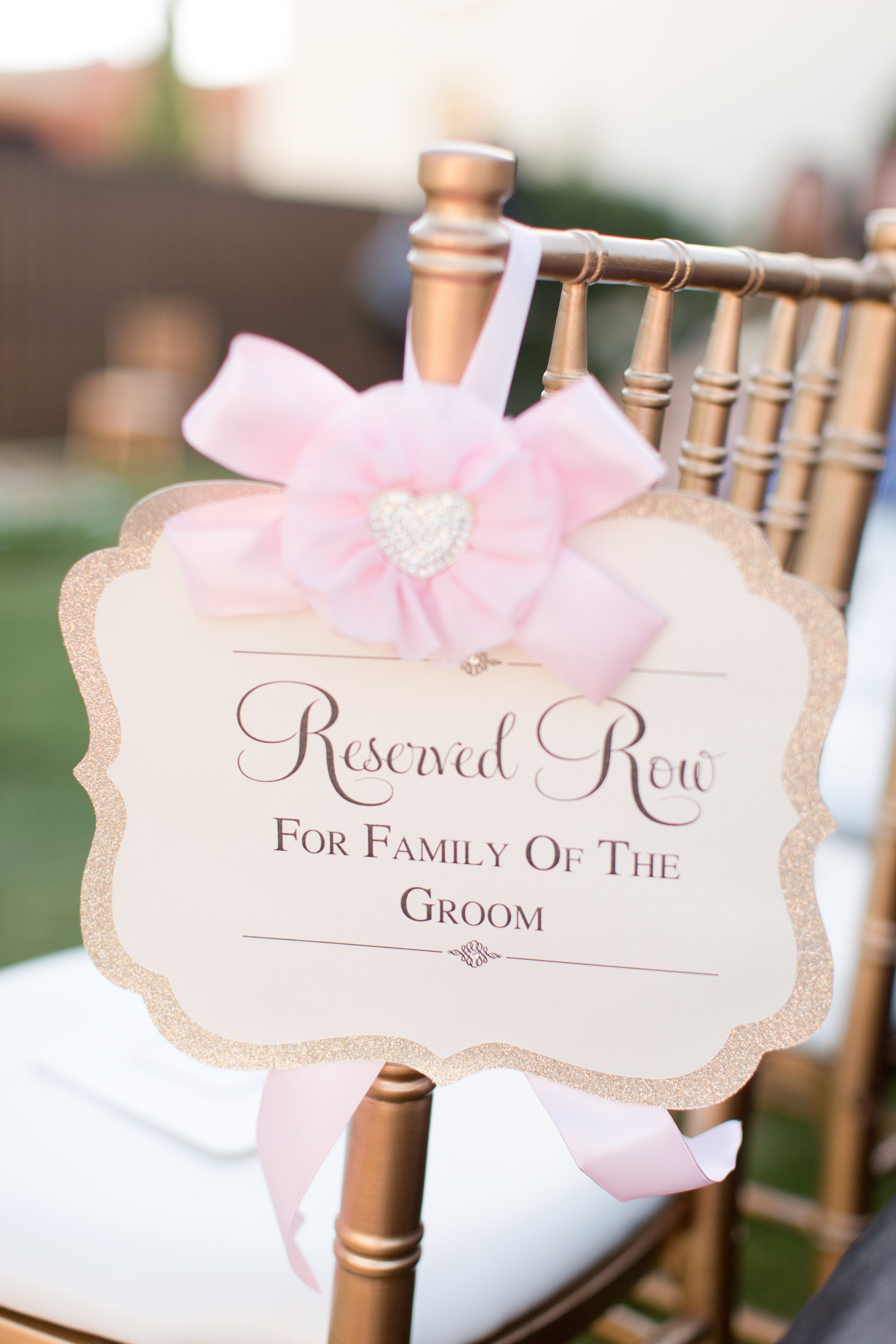 reserved signs for chairs template ergonomic office chair malaysia romantic pink rose wedding seating weddings