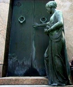 Metarie Cemetery, New Orleans - it was rumored that the statue of the woman in front of the tomb would come to life and walk the cemetery grounds at night. It was later discovered that a street light reflecting off the tomb gave it a reddish glow, lending credence to the rumors of the haunting.