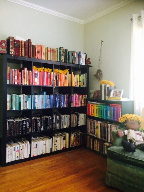 b00kstorebabe:  Last night I color-coded my bookshelf, despite years of decrying it as silly and illogical.  It's so pretty. Also, I need a new bookshelf because every cube is double-stacked whoops