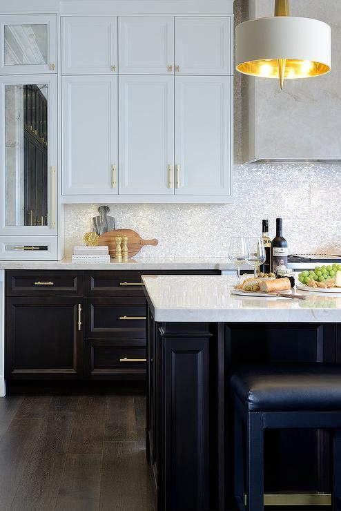 White And Brown Kitchen Features White Upper Cabinets And