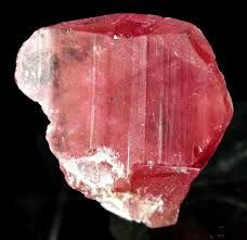 Pezzottaite, marketed under the name raspberyl or raspberry beryl, is a newly identified mineral species, first recognized by the International Mineralogical Association in September 2003. Pezzottaite is a caesium analogue of beryl, a silicate of caesium, beryllium, lithium and aluminium, with the chemical formula Cs(Be2Li)Al2Si6O18. Named after Italian geologist and mineralogist Federico Pezzotta.Hardness 8.