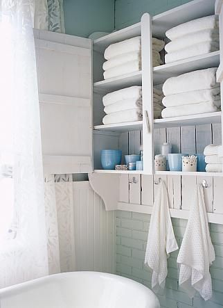 Sarah Richardson Design inc  Season 2 Caroline's Bathroom -- love everything about this bathroom, rustic cabinet - everything to hand when you're IN the bath