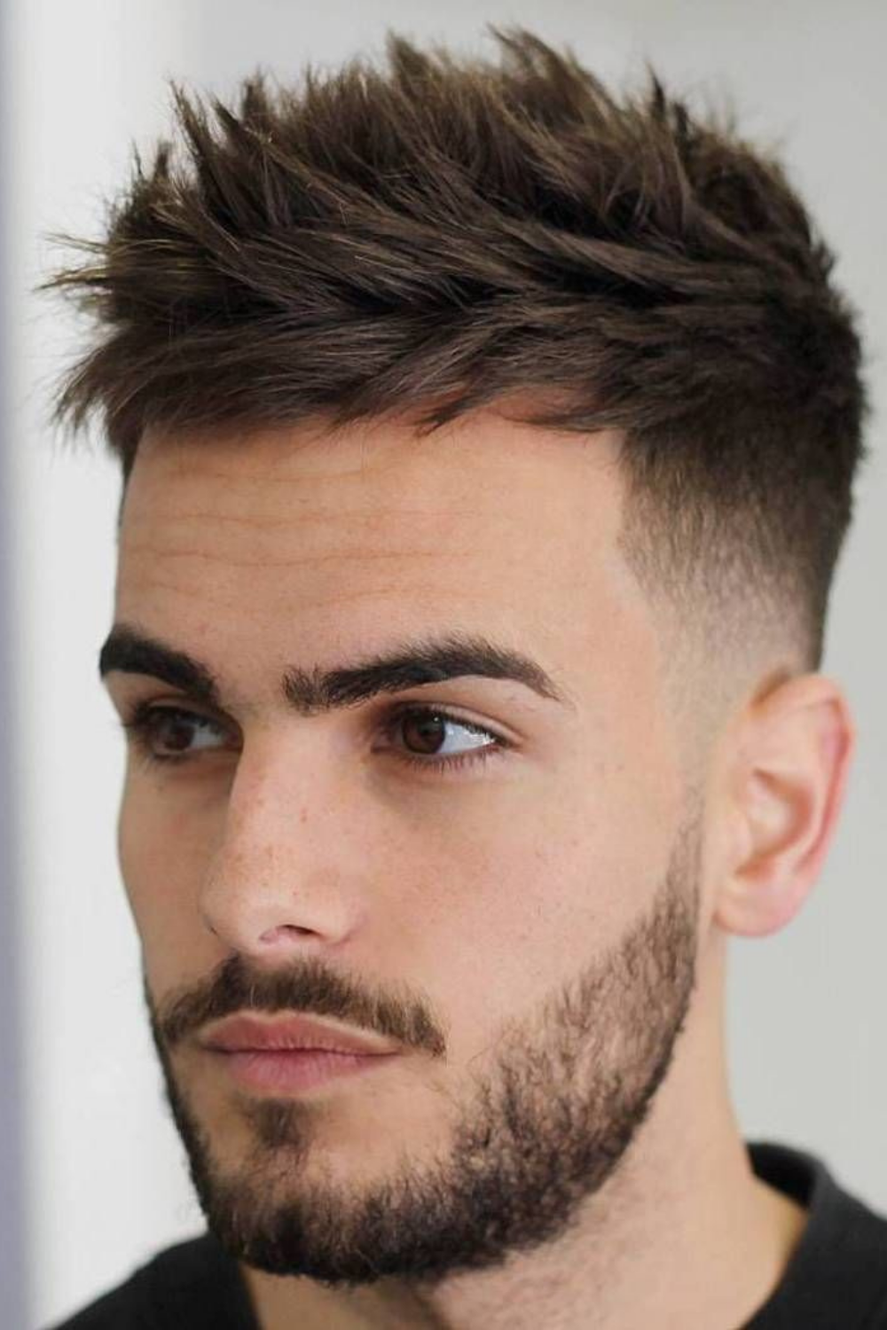 Faded Sides Up Volume And Grown Beard Faded Hair Short Textured Haircuts Men Haircut Styles