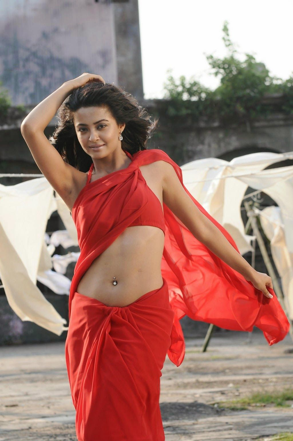 Actress Surveen Chawla spicy photo-shoot in red saree. View more ...