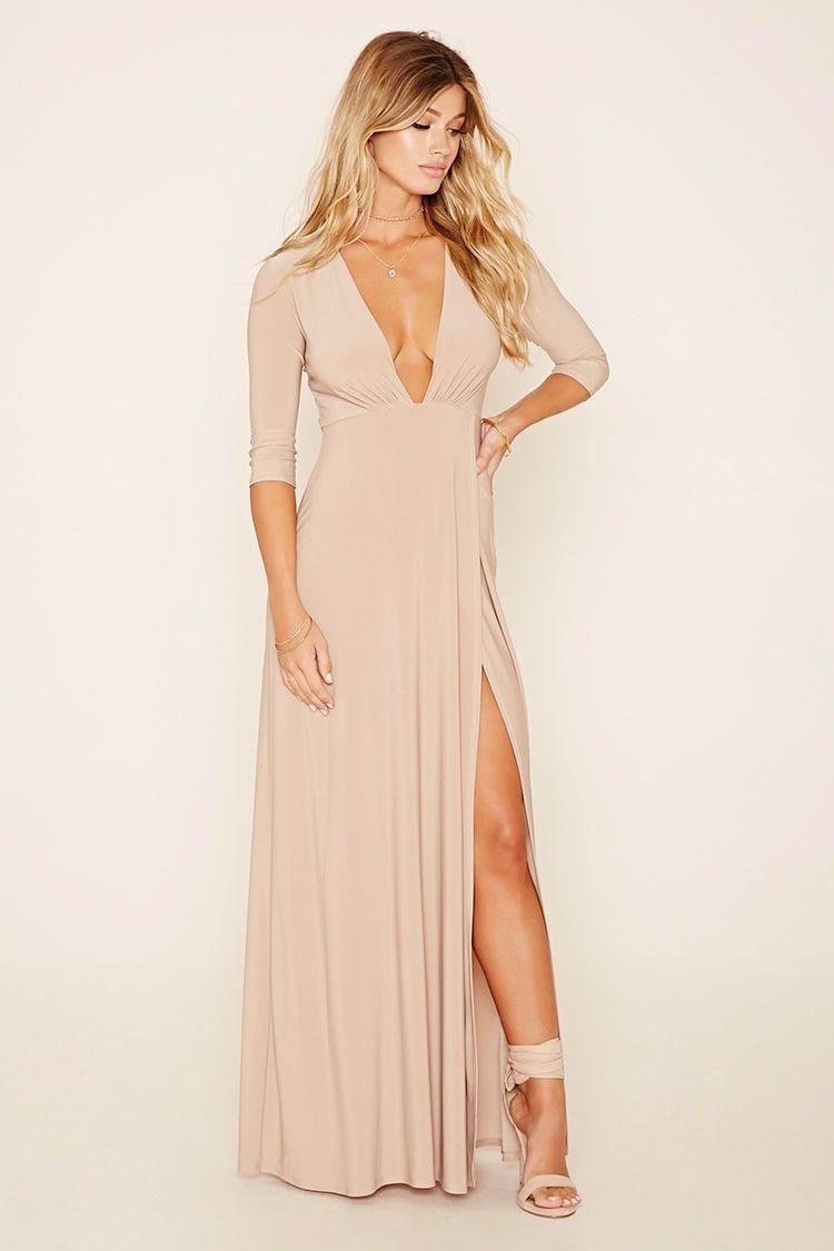 A stretchknit maxi dress with an asymmetrical hem sleeves and