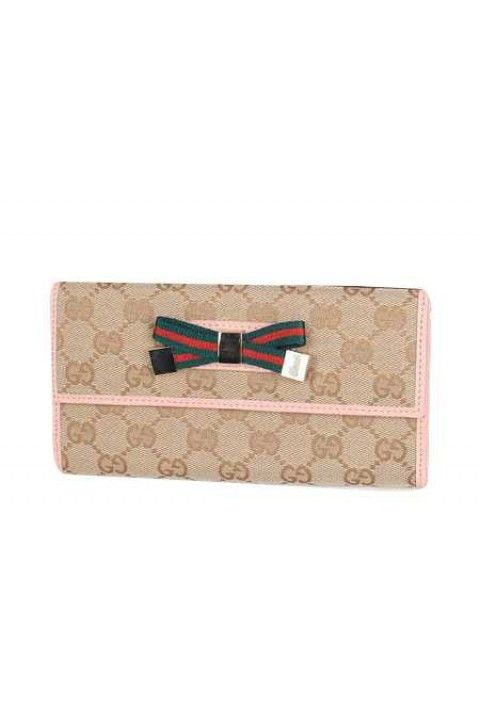 ad3ea095217 Beige GG fabric with pink leathertrim interior Bow detail at front Tab snap  closure Seven card slots and two bill compartments Separate coin pocket  W19.5