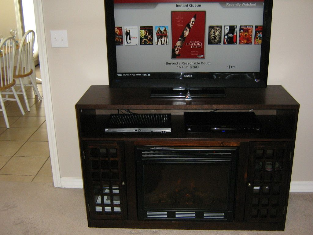 Find a Narita Espresso Media Console and Electric Fireplace with Remote Control on Amazon and Craigslist.