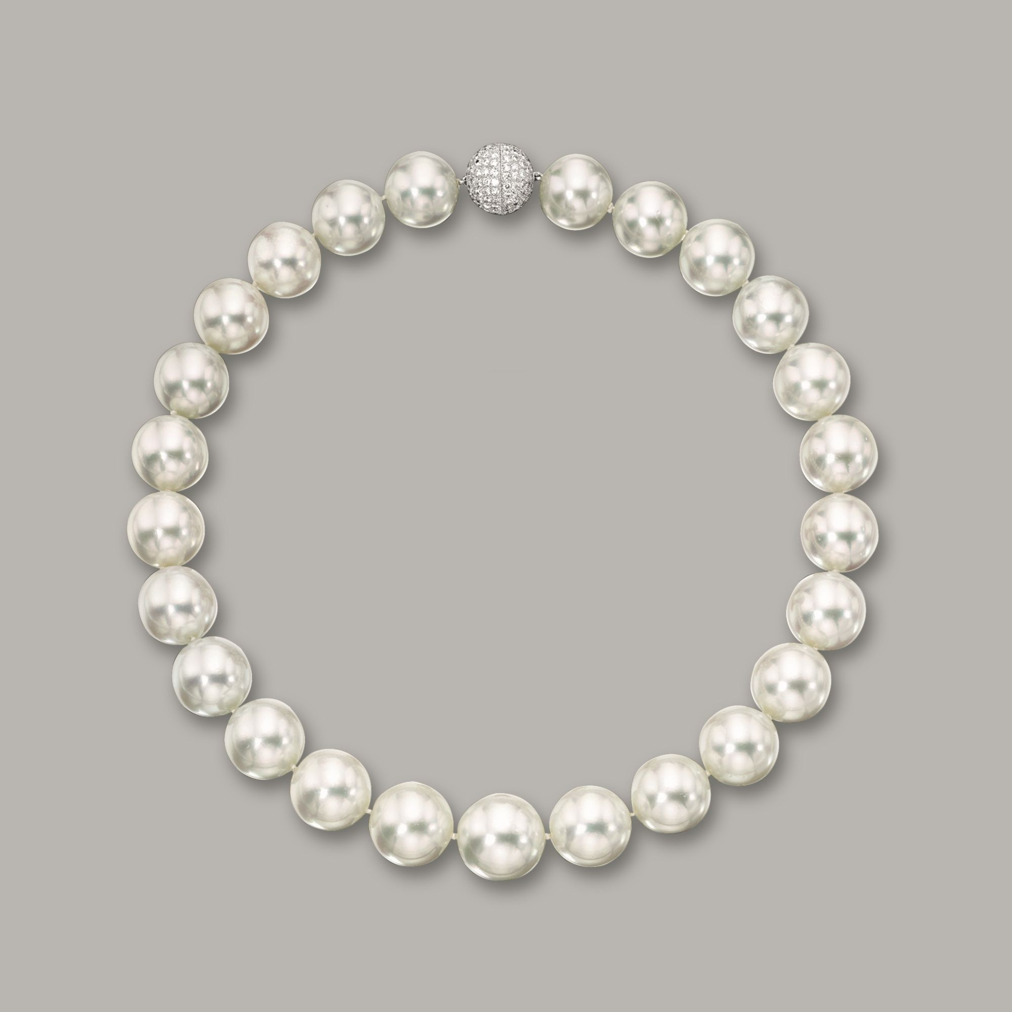 CULTURED PEARL AND DIAMOND NECKLACE- Composed of twenty-five cultured pearls measuring approximately 16.20 to 18.50mm, completed by a brilliant-cut diamond-set spherical clasp, the diamonds together weighing approximately 3.50 carats