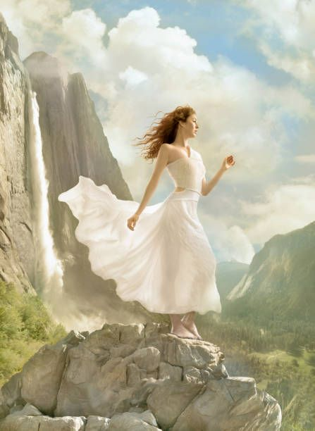Caucasian Blonde Woman Overlooking Limestone Mountains In