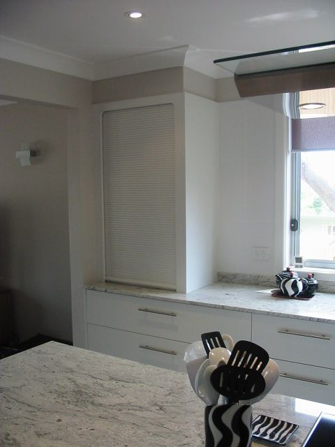 View Of Kitchen Liance Cabinet Roller Shutter Full Height