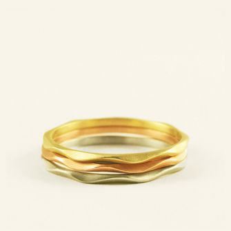 these are so sweet and pretty i wanted them as my wedding band...my wonderful idea was vetoed and i loooove my wedding ring, but i do have lots of other fingers left :D