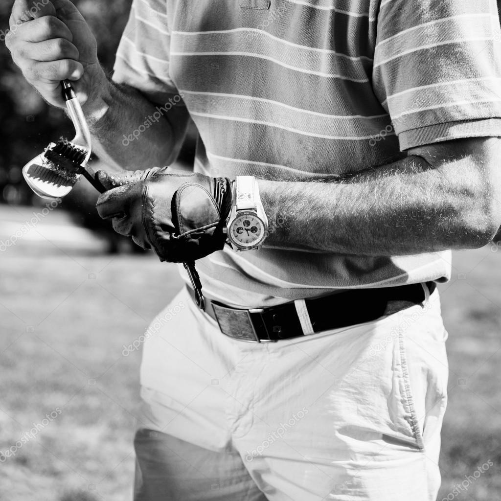 Golfer cleaning iron golf club stock image spon iron