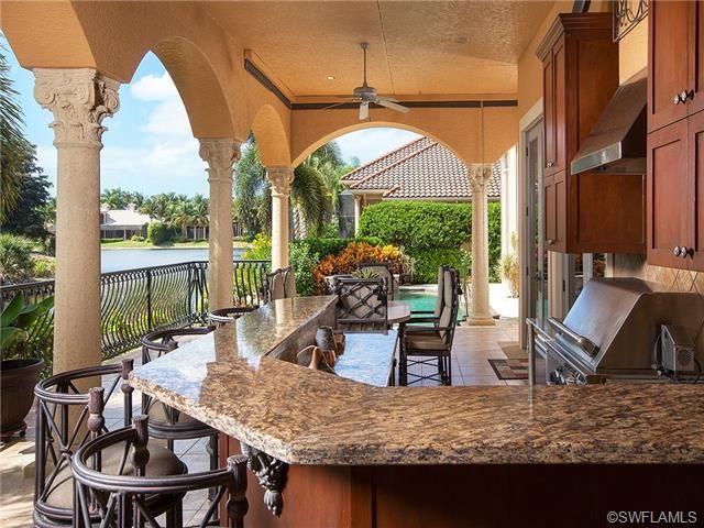 Lanai With Summer Kitchen Marble Columns Bar Seating World Decor Outdoor Entertaining Spaces Florida Home