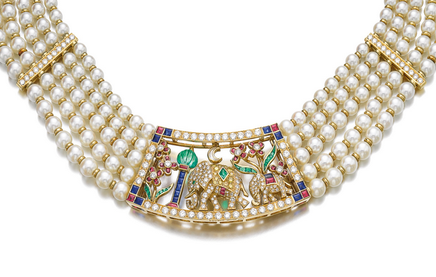 Gem set and cultured pearl necklace, Cartier: Set with a plaque of Indian inspiration, decorated with variously shaped rubies, sapphires, emeralds and diamonds, on a cultured pearl necklace accented with gold rondelles and brilliant-cut diamonds, length approximately 360mm, signed Cartier, numbered, French assay and maker's marks.