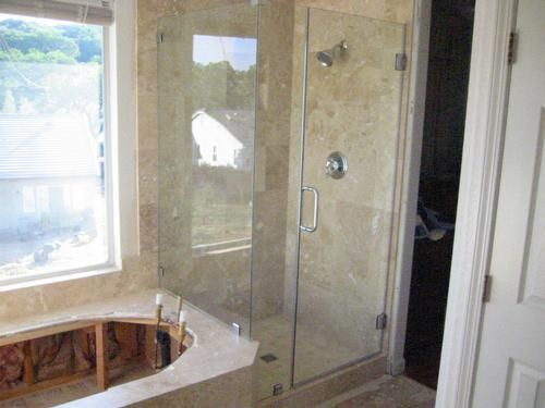 Travertine Shower Tile Install Completed Frameless Glass Enclosure Bathtub Platform Awaiting The Installation Of