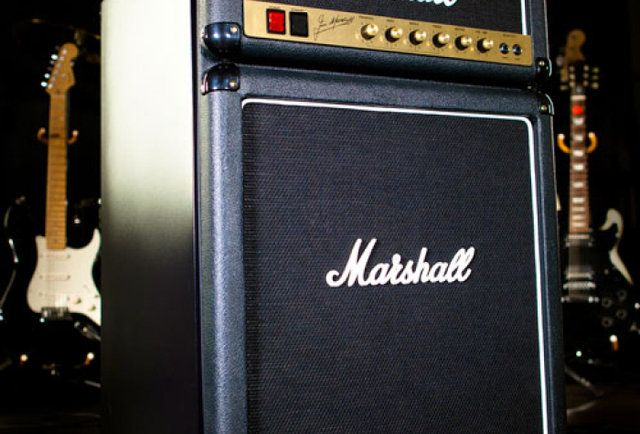 """Resembling a legit Marshall half-stack w/ authentic logos, knobs, inputs, and speaker cloth, the front panel of this beast opens to reveal a 4.4-cubic ft mini-fridge with a high-efficiency freezer up top, and """"convenient can storage"""" below for your Steve Miller Lites."""