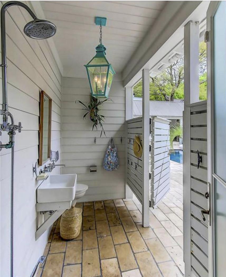 Outdoor shower area pool shiplap lantern sink outdoor bath