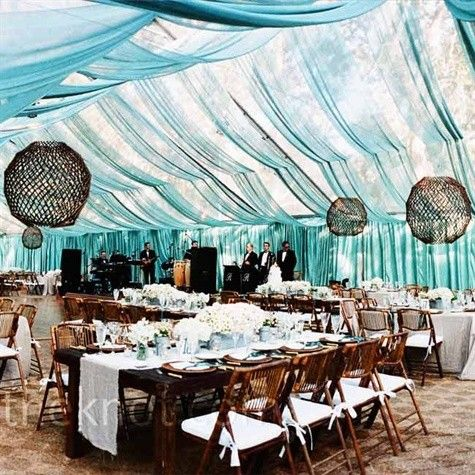 Clear tent draped with sheer fabric for color. Gives natural light for day. For night, drape Xmas lights inside. Guests will be able to see the stars. Loving this!