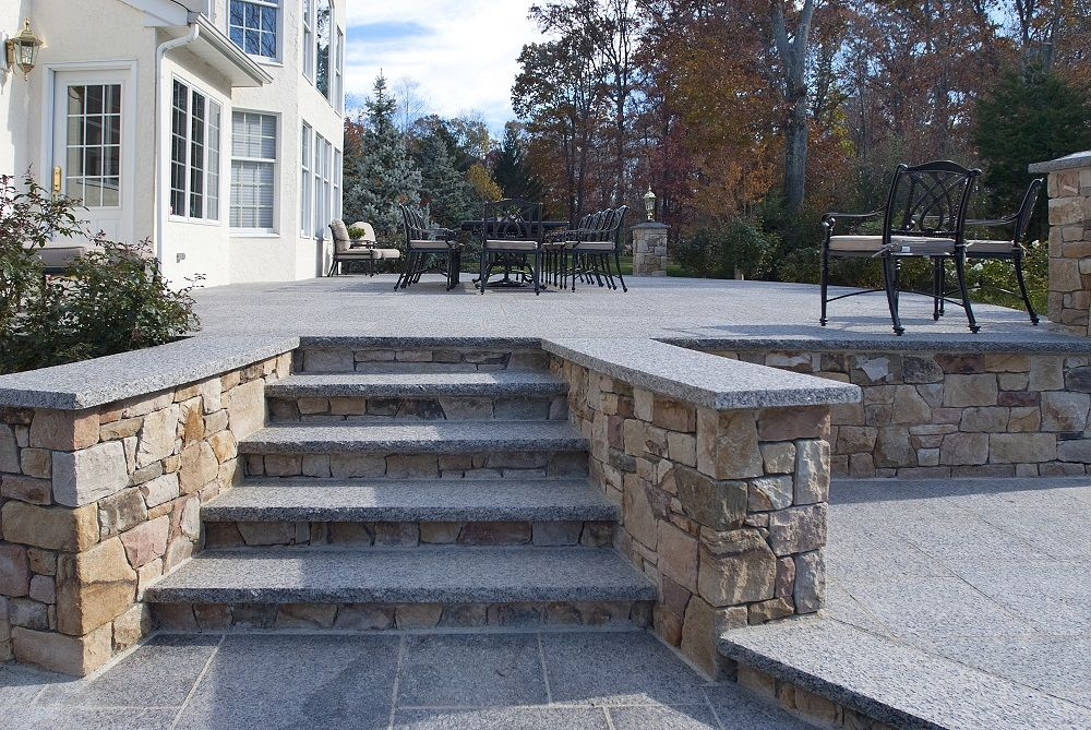 These Back Steps To A Patio Have Caledonia Granite Steps