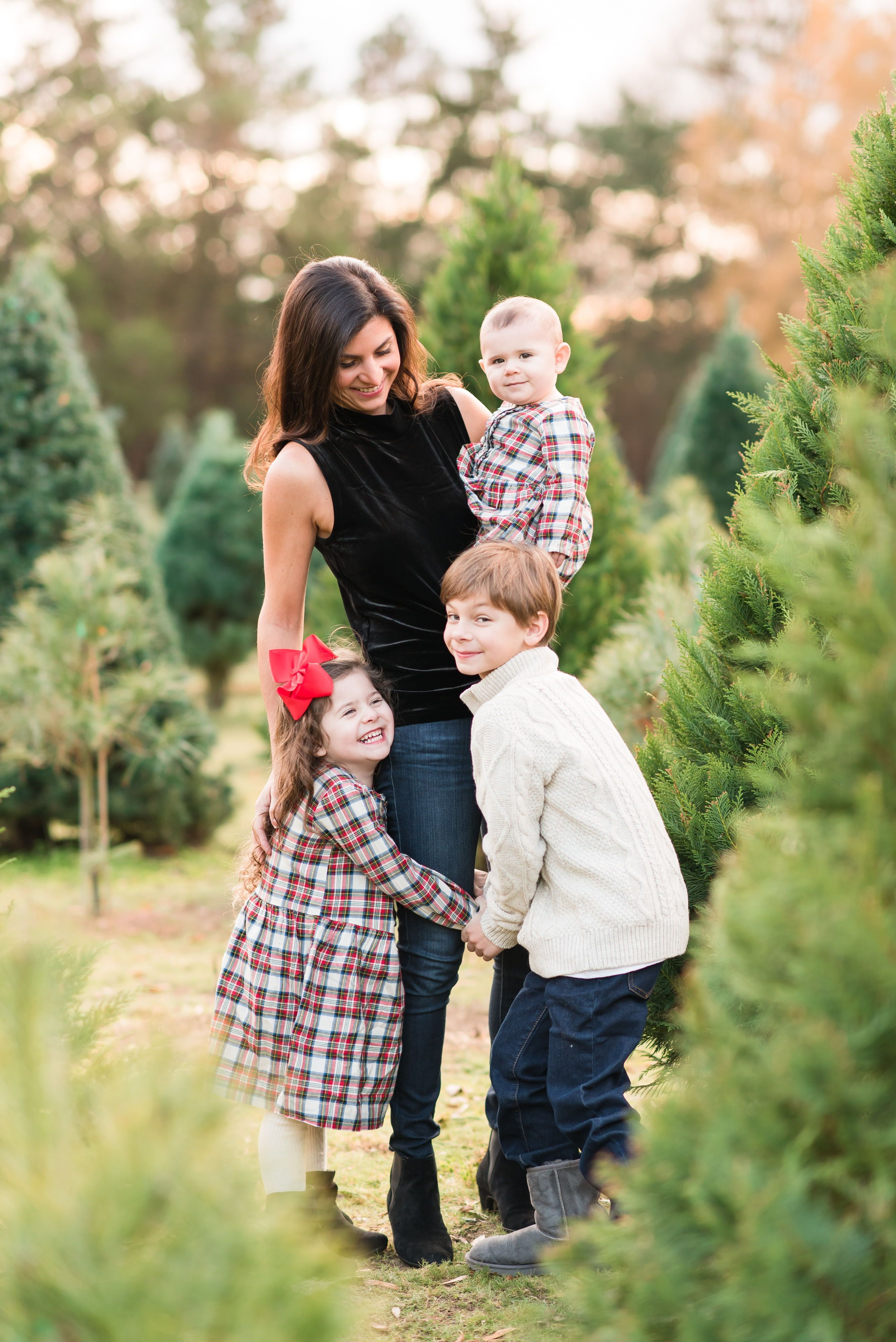 A Christmas Tree Farm Lifestyle Family Session With A Mother And Her Three Little Ones Couple Photos Farm Lifestyle