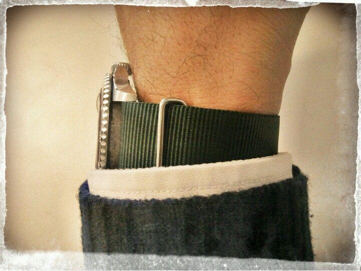 Rolex Submariner with dark green nylon strap...
