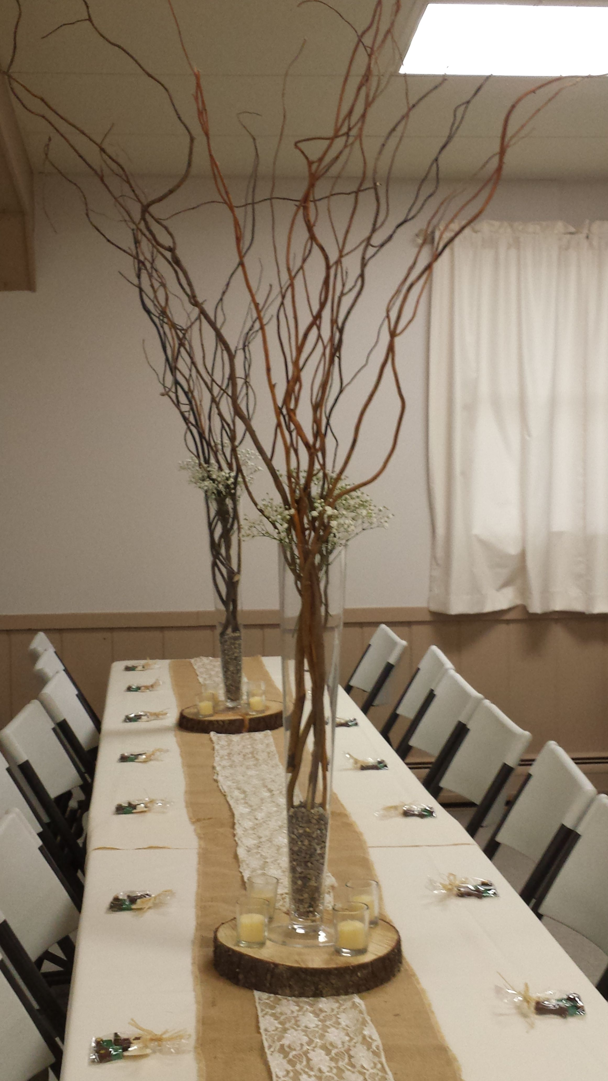 Tall Curly Willows With Baby Shower Breath In A Trumpet Vase On Wood Slab With Wood Slab Centerpiece Wood Slice Centerpiece Wedding Rustic Wedding Centerpieces