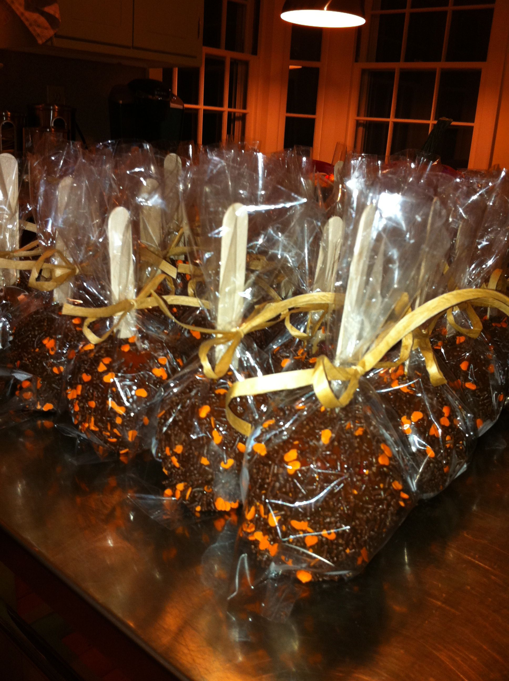 Hand dipped caramel apples covered in chocolate sprinkles