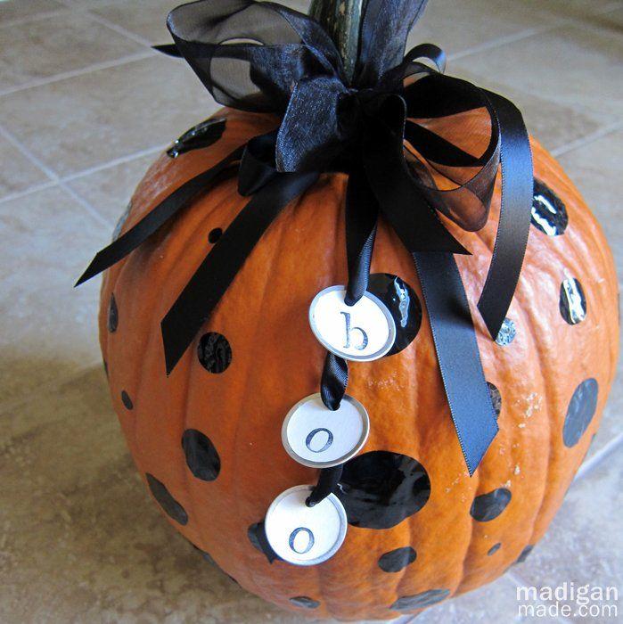 a polka dot pumpkin with vinyl dots - instructions at madiganmade