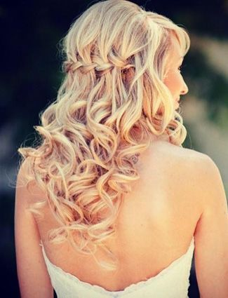 Get Inspired: Be sassy and fab on your wedding day with this curly braid half updo style.