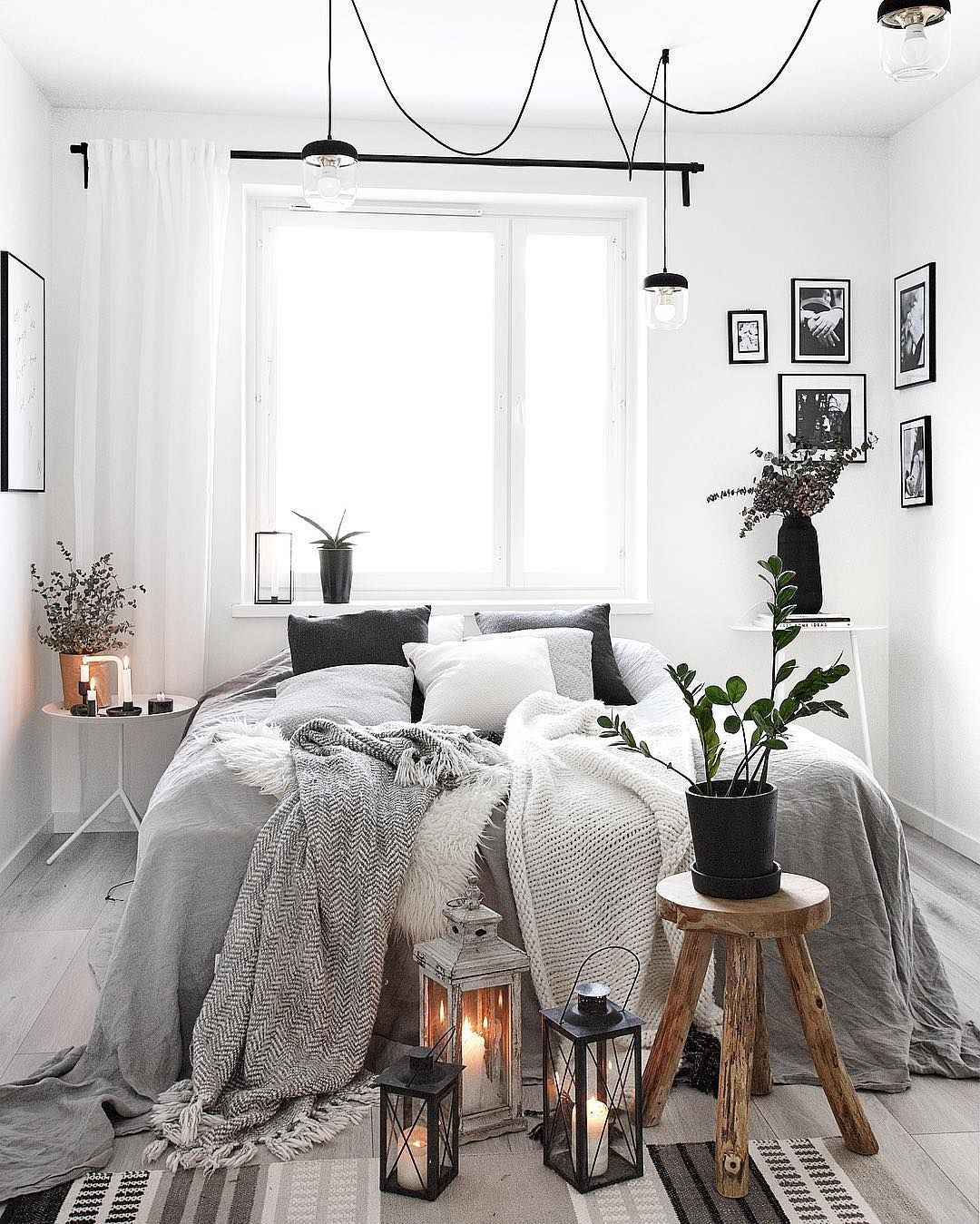 Cozy modern bedroom in shades of grey.  White bedroom decor