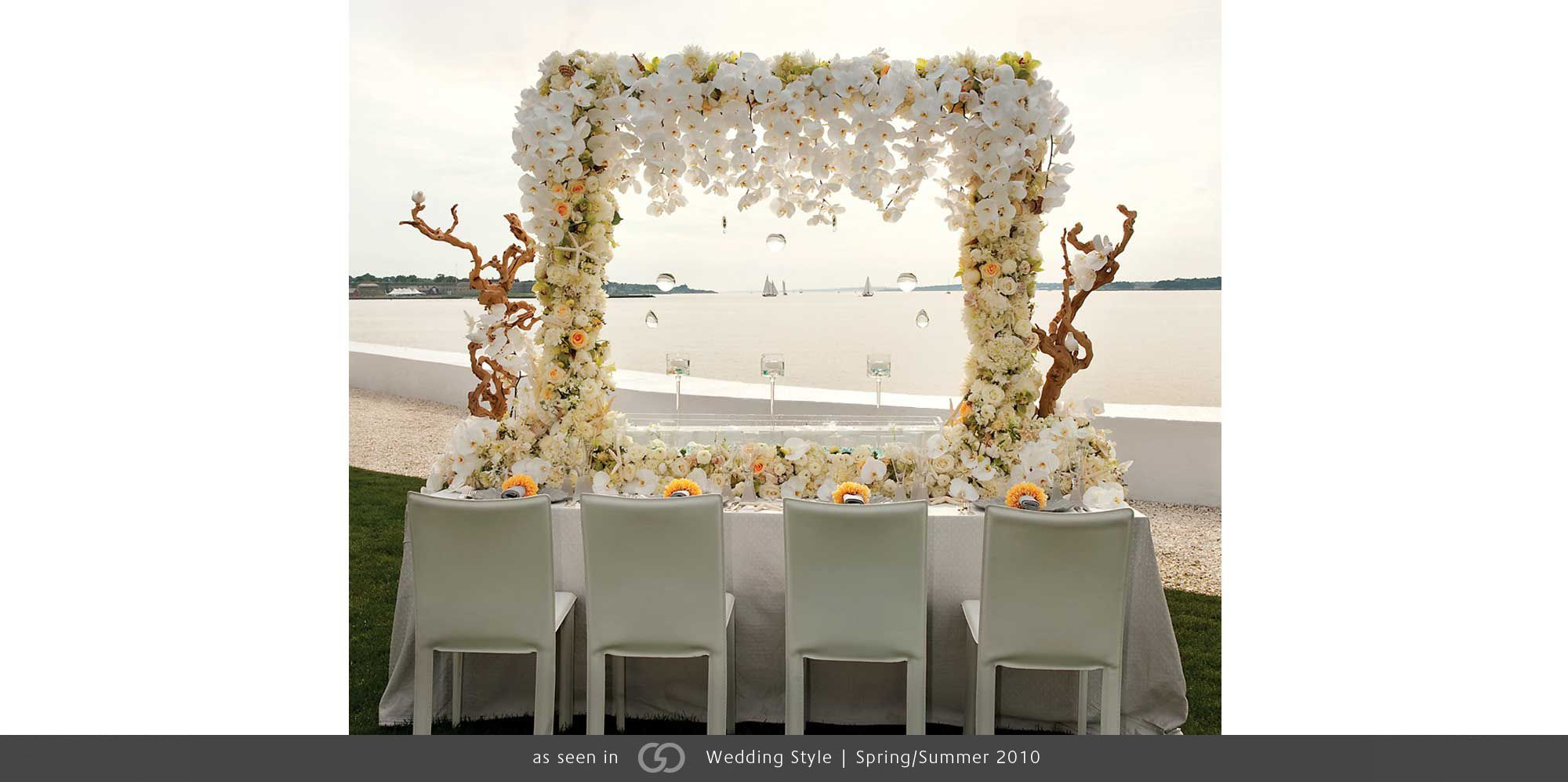 bell mer newport wedding tabletop white orchid arbor seashell photo: day orchid decor