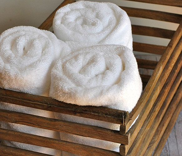 Use a rustic wood egg crate to organize towels