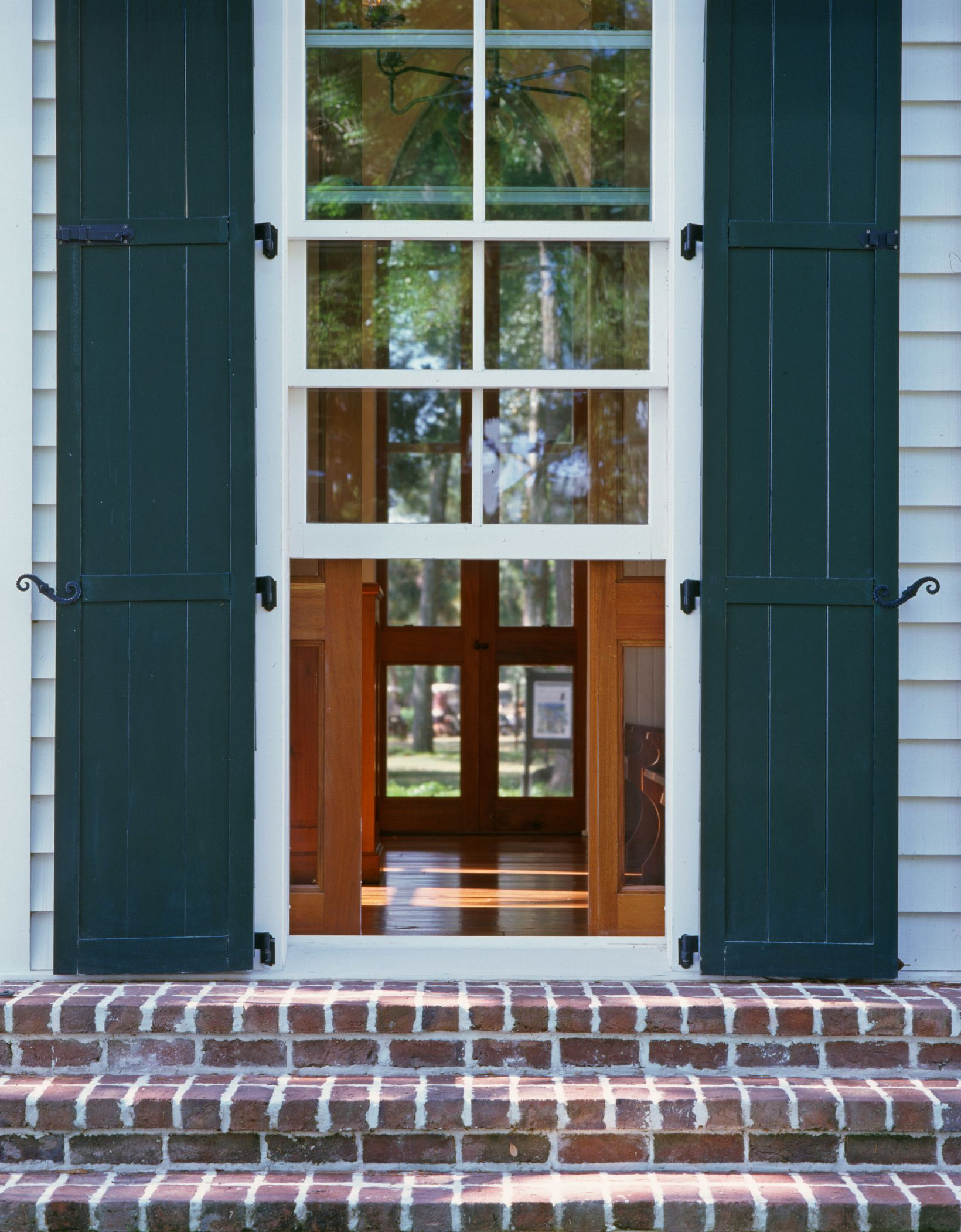 Triple hung window with sliding pocket screens chapel at for Pocket screens sliding doors
