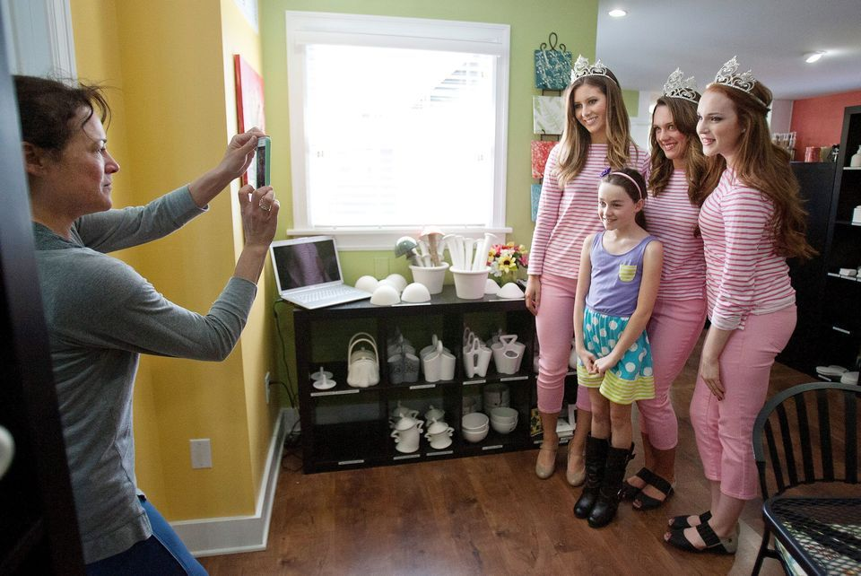 Ruby Jefferson, 8, Seattle, gets her picture taken by her aunt, Cathy Roozen, Wenatchee, with the royalty. They were at Inspirations Ceramics Cafe to decorate ceramics. World photo/Don Seabrook
