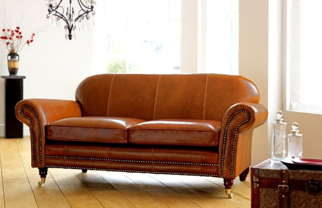 vintage leather sofa company big cushions online india if you are looking for a settee then this elegant by the english with mahogany legs and studded facing may just be