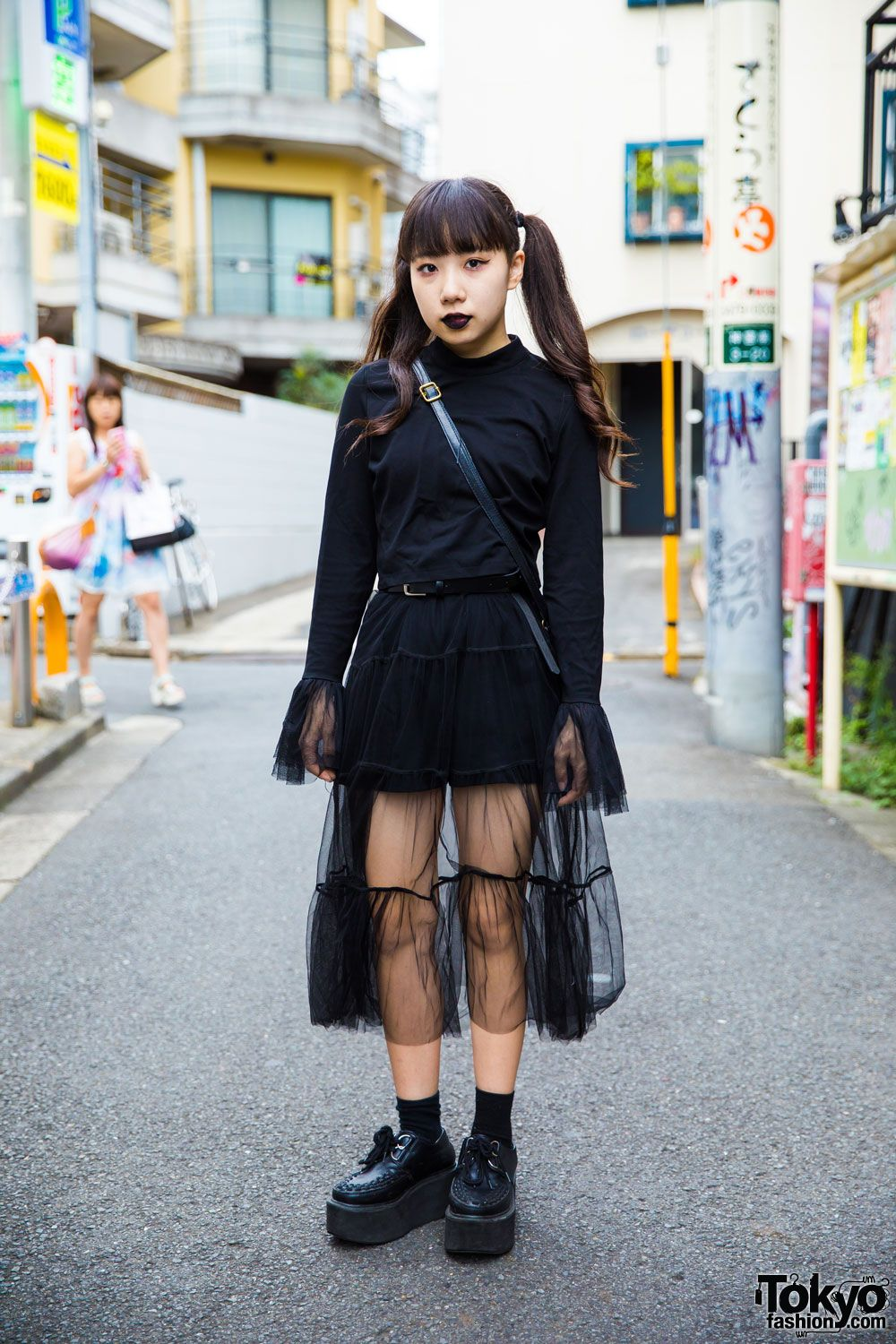 4b7a789b0 Bemi's all black fashion style features a vintage sweater with extra long  sleeves and sheer cuff, a black sheer skirt from Nadia Harajuku, black  socks, ...