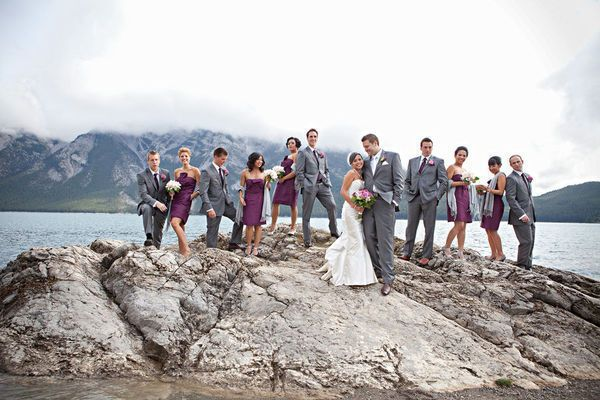 Great combo of gray and purple for the bridal party.  Natural scenery makes this a great picture.
