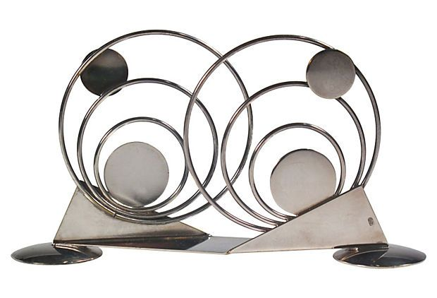 1920s Art Deco napkin holder with circular and geometric designs.