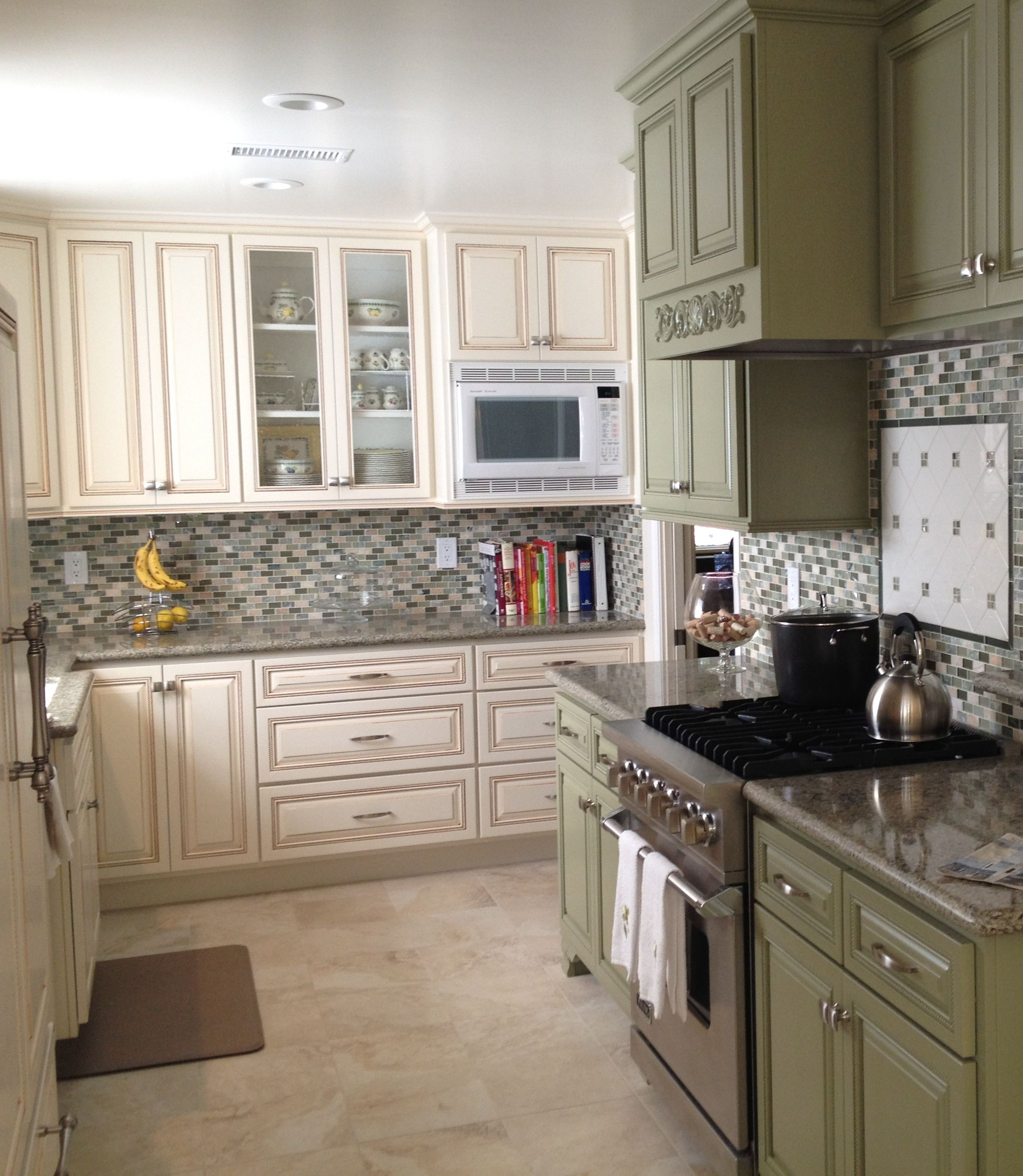 Pearl white cabinets with carmel glaze seafoam green on for Pearl white kitchen cabinets