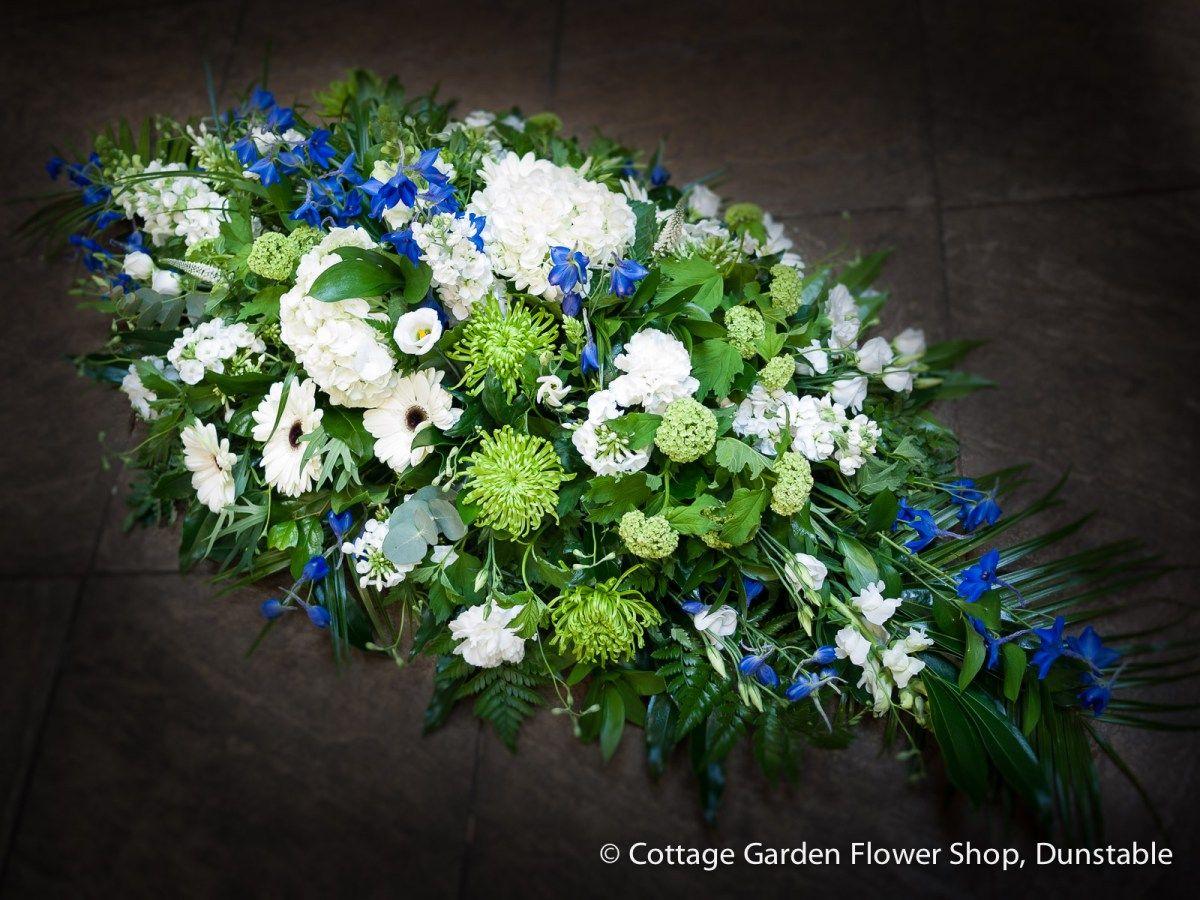 Blue white green casket spray casket funeral flowers and flowers blue white green casket spray the cottage garden flower shop dunstables original florists izmirmasajfo Gallery