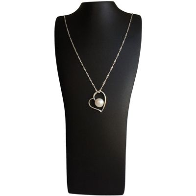 Exclusive sterling silver heart pendant and chain set with large freshwater pearl.