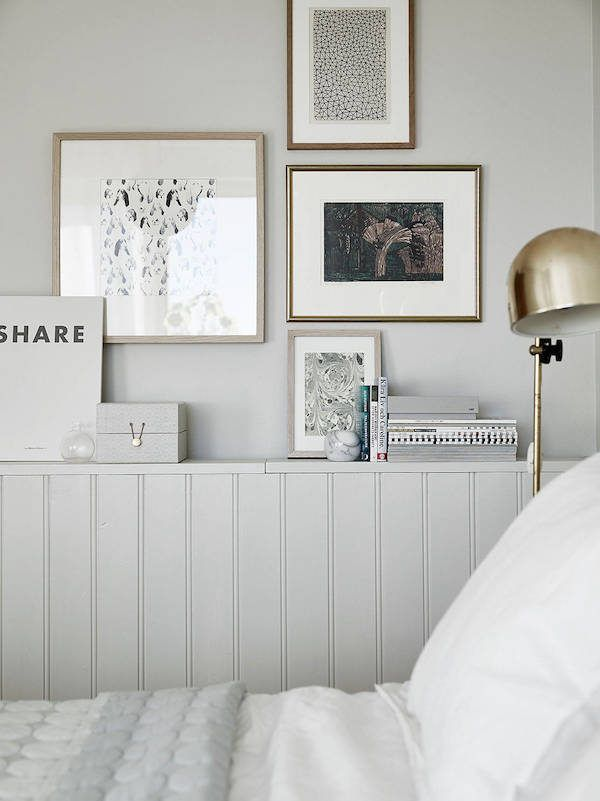 Swedish Bedrooms wainscoting / ledge and a gallery wall in a swedish bedroom