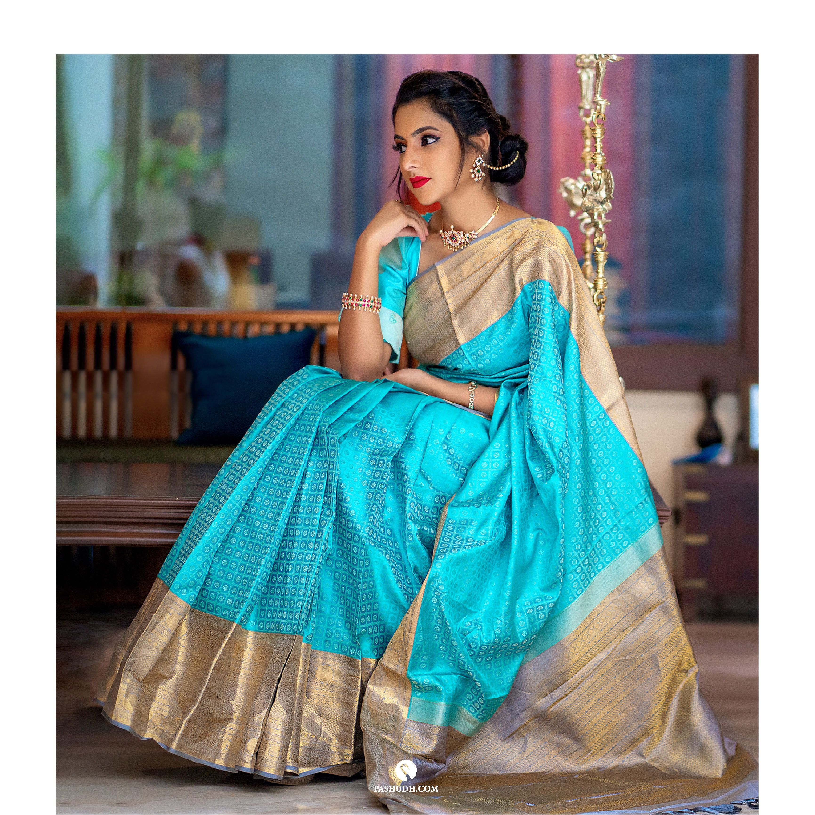 """Turquoise blue silk saree with grey border"""" from Sita"""