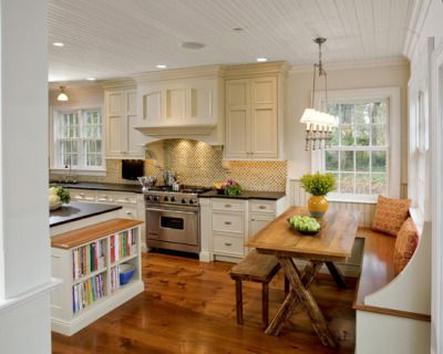 Built In Banquette Seating And Cookbook Storage In This Kitchen Designed By  Village Handcrafted Cabinetry.