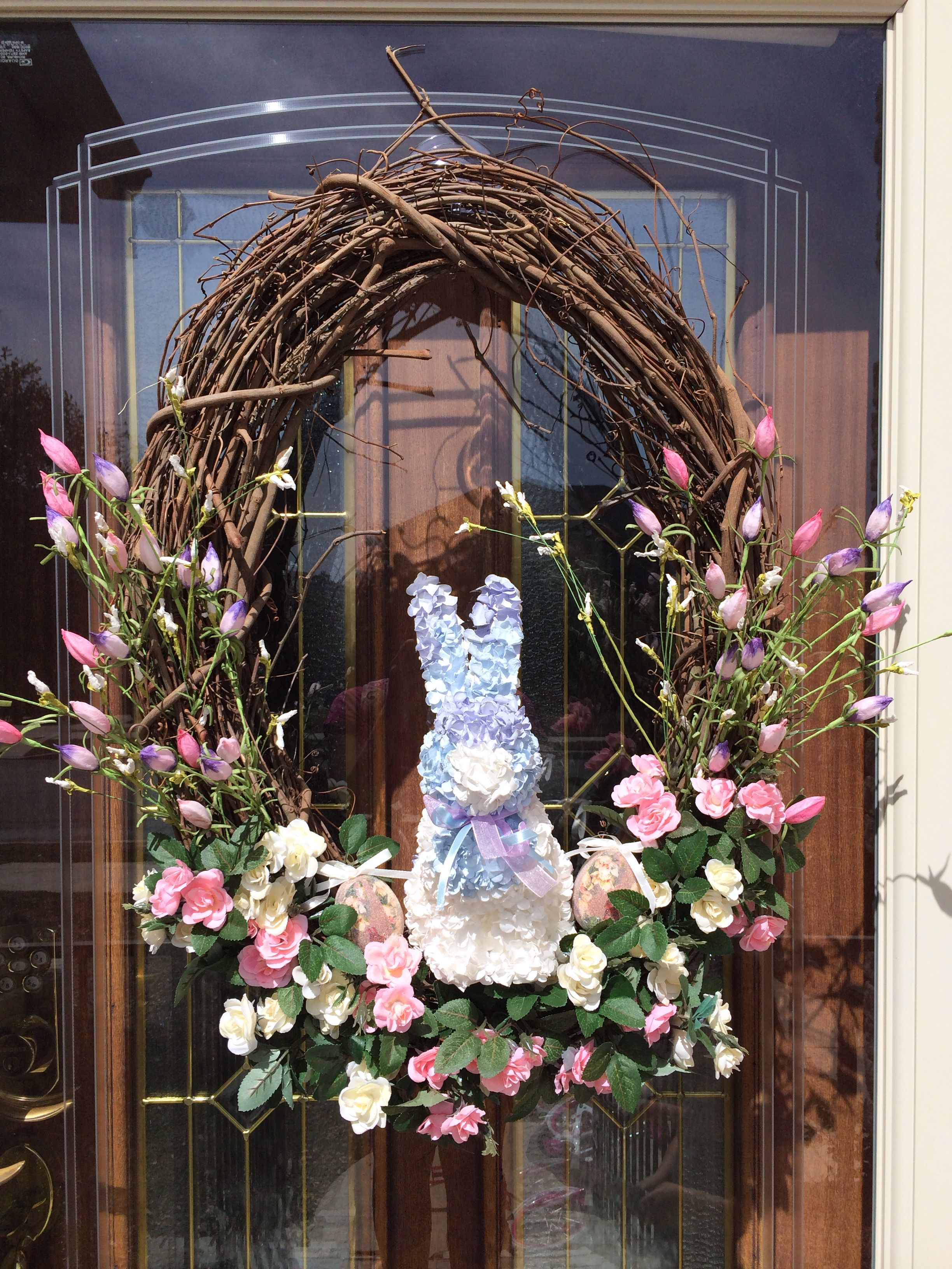 Easy and inexpensive Easter Wreath. Pick a bunny or center piece and add any floral you like.